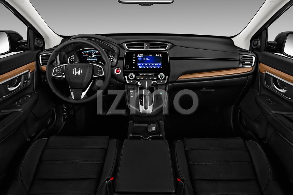 Stock photo of straight dashboard view of 2017 Honda CR-V EX-L 5 Door SUV Dashboard