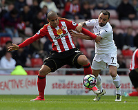 SUNDERLAND, ENGLAND - MAY 13: (L-R) Wahbi Khazri of Sunderland is challenged by Leon Britton of Swansea City during the Premier League match between Sunderland and Swansea City at the Stadium of Light, Sunderland, England, UK. Saturday 13 May 2017