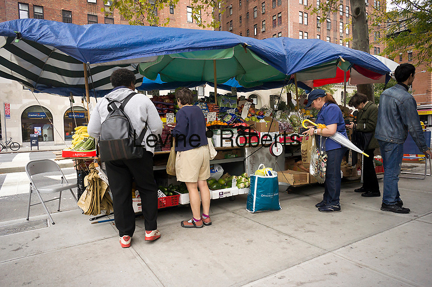 A fruit and vegetable stand in the Chelsea neighborhood of New York on Monday, October 15, 2012.  (© Richard B. Levine)
