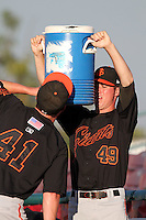 San Jose Giants pitcher Michael Main #49 helps teammate Craig Westcott with a drink of water before a game against the Inland Empire 66'ers at Arrowhead Credit Union Park on August 1, 2011 in San Bernardino,California. San Jose defeated Inland Empire 2-1.(Larry Goren/Four Seam Images)