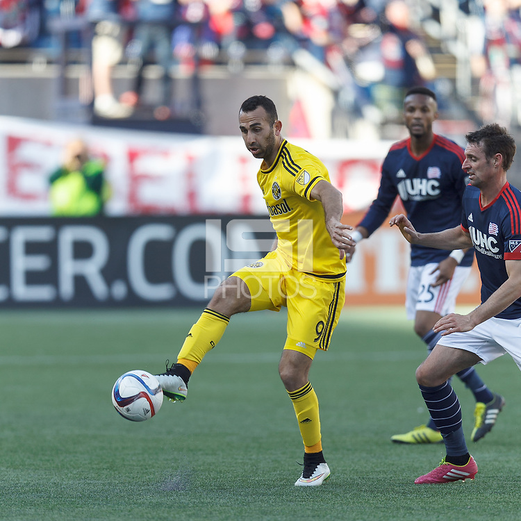 Foxborough, Massachusetts - April 11, 2015: In a Major League Soccer (MLS) match, the New England Revolution (blue/white) tied Columbus Crew (yellow), 0-0, at Gillette Stadium.<br /> .