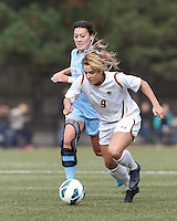 Late in the game, Boston College forward Stephanie McCaffrey (9) on the attack.   University of North Carolina (blue) defeated Boston College (white), 1-0, at Newton Campus Field, on October 13, 2013.