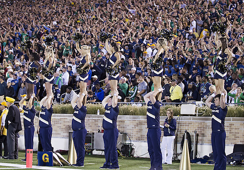 September 06, 2014:  A general view of the Notre Dame cheerleaders an student section during NCAA Football game action between the Notre Dame Fighting Irish and the Michigan Wolverines at Notre Dame Stadium in South Bend, Indiana. Notre Dame defeated Michigan 31-0.