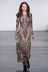 """Model Yue walks runway in a techno mesh midi dress with Ikat motif burnout, from the Vivienne Tam Fall Winter 2016 """"Cultural Dreamland The New Silk Road"""" collection, presented at NYFW: The Shows Fall 2016, during New York Fashion Week Fall 2016."""