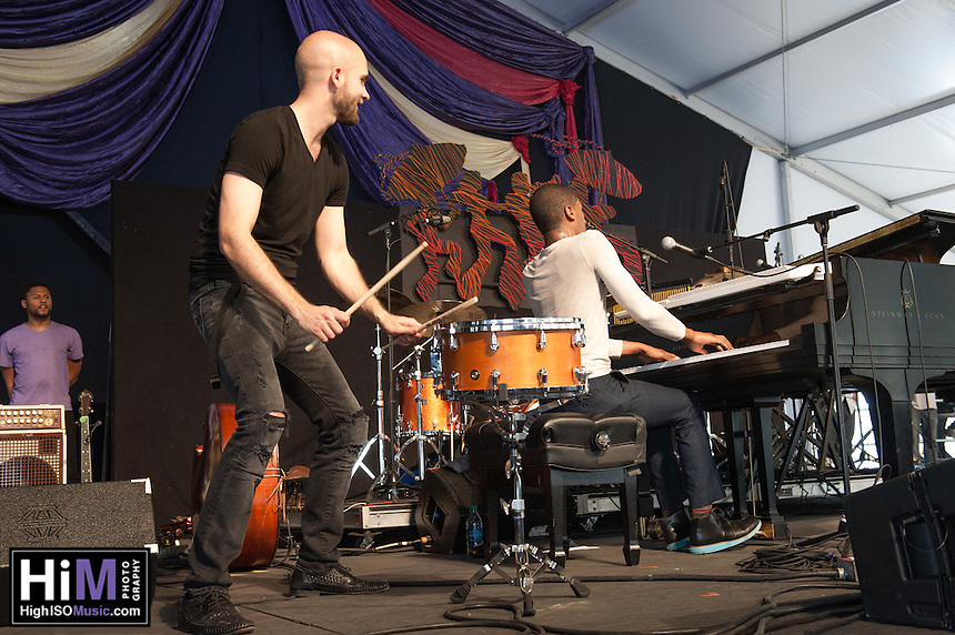 Jon Battiste  performs at the 2014 Jazz and Heritage Festival in New Orleans, LA.