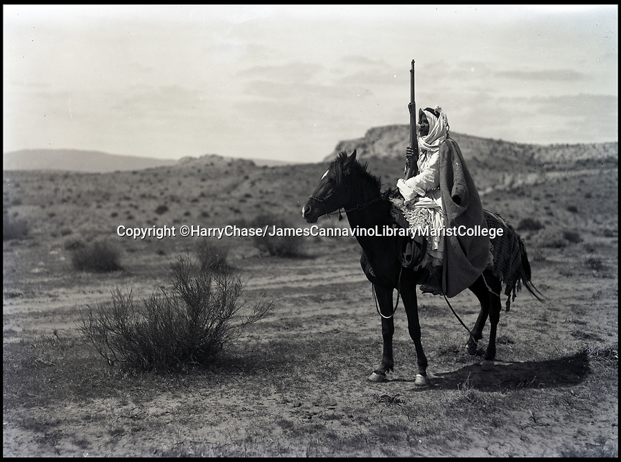 Bournemouth News (01202 558833)<br /> Pic: HarryChase/BNPS<br /> <br /> Bedouin sheik on horse in the desert.<br /> <br /> Fascinating never before seen photos of the Arab Revolt have revealed Lawrence of Arabia actually had help from a plucky band of British troops as well as the Arab tribesmen.<br /> <br /> A new book reveals the legendary campaign, that did much to shape the modern map of the Middle East, used cutting edge weapons like Rolls Royce armoured car's and British crewed aircraft to attack the Turkish enemy alongside the native arab army.<br /> <br /> The photos feature in military historian James Stejskal's new book Masters of Mayhem which sheds new light on T.E Lawrence's achievements fighting alongside Arab guerrilla forces in the Middle East during the First World War.<br /> <br /> They had been tucked away in the private photo albums of the descendants of soldiers who fought alongside Lawrence during the campaign.<br /> <br /> One historically important photo shows Lawrence and his driver sitting in a Rolls Royce in Marjeh Square in Damascus after it was captured in October 1918.<br /> <br /> Another documents the dramatic moment a water tower and windmill pump are blown up in the desert.
