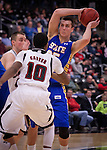OMAHA, NE - South Dakota State's Chad White passes the ball over the hands of University of Nebraska at Omaha defender CJ Carter #10 during their game Thursday evening at Ralston Arena in Omaha, NE. (Photo By Ty Carlson/DakotaPress.org)