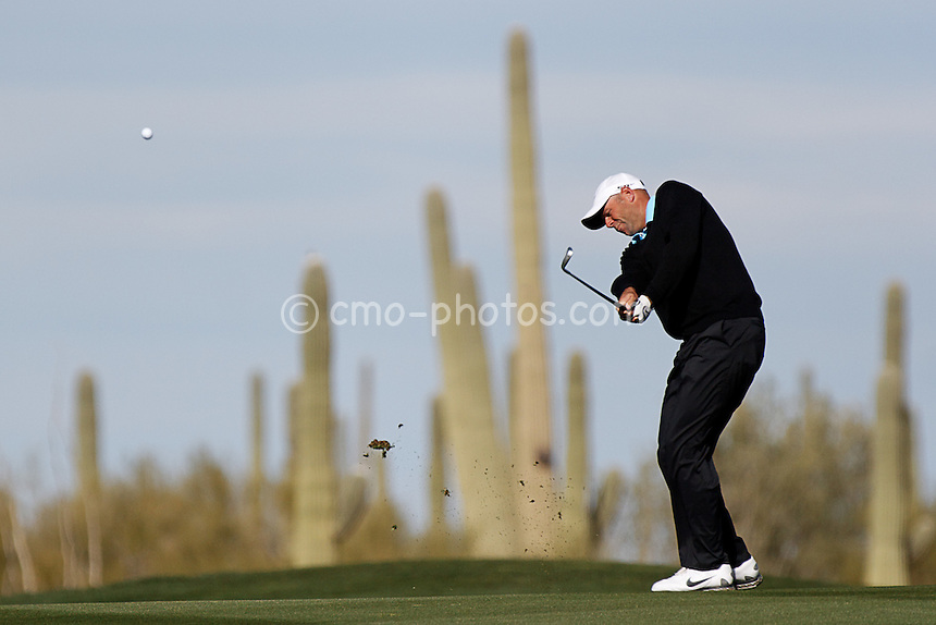 Feb 24, 2008; Marana, AZ, USA; Stewart Cink hits an approach shot towards the 11th green during his final-round match against Tiger Woods (not pictured) at the Accenture Match Play Championship at the Gallery Golf Club. Woods would go on to beat Cink 8 and 7 to earn his third victory in the WGC match play event and 15th victory overall in the World Golf Championship series.