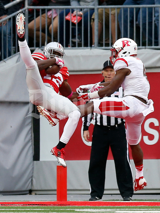 Ohio State Buckeyes cornerback Doran Grant (12) intercepts a pass intended for Rutgers Scarlet Knights wide receiver Leonte Carroo (4) during the second quarter of the NCAA football game at Ohio Stadium in Columbus on Oct. 18, 2014. (Adam Cairns / The Columbus Dispatch)