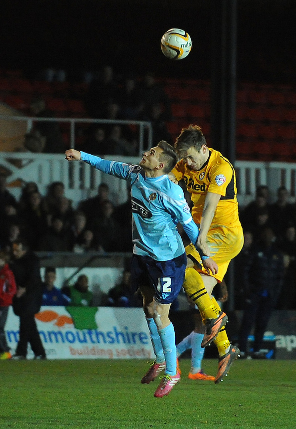 Dagenham and Redbridge's Lawson D'Ath vies for possession with Newport County's Max Porter<br /> <br /> Photo by Kevin Barnes/CameraSport<br /> <br /> Football - The Football League Sky Bet League Two - Newport County AFC v Dagenham &amp; Redbridge - Wednesday 19th March 2014 - Rodney Parade - Newport<br /> <br /> &copy; CameraSport - 43 Linden Ave. Countesthorpe. Leicester. England. LE8 5PG - Tel: +44 (0) 116 277 4147 - admin@camerasport.com - www.camerasport.com