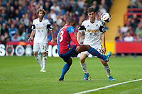 Sun 22 September 2013<br /> <br /> Pictured: Jason Puncheon of Crystal Palace keeps the ball in while Jose Canas  of Swansea and Ben Davies of Swansea look on <br /> <br /> Re: Barclays Premier League Crystal Palace FC  v Swansea City FC  at Selhurst Park, London
