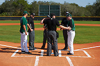 Dartmouth Big Green head coach Bob Whalen (2) during the lineup exchange with Eastern Michigan Eagles head coach Mark Van Ameyde (left) and the umpires - including Mike Savakinas (home) and Zach Tieche (left) on February 25, 2017 at North Charlotte Regional Park in Port Charlotte, Florida.  Dartmouth defeated Eastern Michigan 8-4.  (Mike Janes/Four Seam Images)
