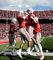 Ohio State Buckeyes cornerback Jeffrey Okudah (1) celebrates with Ohio State Buckeyes safety Isaiah Pryor (12) after he intercepted a pass at the two-yard line during the fourth quarter of a NCAA college football game between the Ohio State Buckeyes and the Minnesota Golden Gophers on Saturday, October 13, 2018 at Ohio Stadium in Columbus, Ohio. [Joshua A. Bickel/Dispatch]