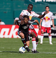 Juan Manuel Pena (3) of D.C. United fights for control of the ball with Salou Ibrahim (29) of the New York Red Bulls at RFK Stadium in Washington, DC.  The New York Red Bulls defeated D.CC United, 2-0.