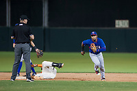 AZL Rangers shortstop Yonny Hernandez (59) jogs off the field after applying a tag to AZL Giants first baseman Nathanael Javier (47) on September 4, 2017 at Scottsdale Stadium in Scottsdale, Arizona. AZL Giants defeated the AZL Rangers 6-5 to advance to the Arizona League Championship Series. (Zachary Lucy/Four Seam Images)