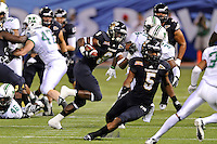 20 December 2011:  FIU running back Kedrick Rhodes (9) carries the ball in the first quarter as the Marshall University Thundering Herd defeated the FIU Golden Panthers, 20-10, to win the Beef 'O'Brady's St. Petersburg Bowl at Tropicana Field in St. Petersburg, Florida.