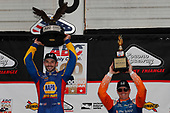 Alexander Rossi, Andretti Autosport Honda, Scott Dixon, Chip Ganassi Racing Honda celebrate on the podium