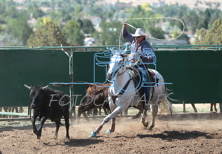 Members of the Centennial Livestock team compete in the team roping event at the Minden Ranch Rodeo in Gardnerville, Nev., on Sunday, July 22, 2012..Photo by Cathleen Allison
