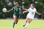 30 September 2012: UNC's Reilly Parker (13) passes the ball past Miami's Jesse Shugg (CAN) (9). The University of North Carolina Tar Heels defeated the University of Miami Hurricanes 6-1 at Fetzer Field in Chapel Hill, North Carolina in a 2012 NCAA Division I Women's Soccer game.