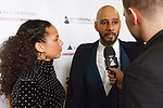 """Musician Alicia Keys and husband Kasseem Dean aka """"Swizz Beatz"""" being interviewed at the Recording Academy Producers & Engineers Wing event honoring Alicia Keys and Swizz Beatz at 30 Rockefeller Plaza in New York City, during Grammy Week on January 25, 2018."""