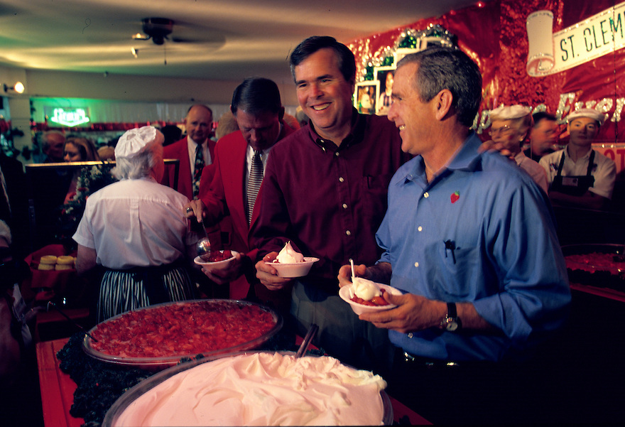 Republican presidential candidate George W. Bush attends a Strawberry Festival in Plant City, Florida with his brother Florida Governor Jeb Bush.