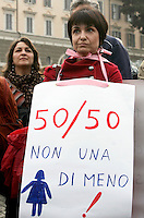 """Se non le donne chi? Se non ora quando?"": manifestazione per il rispetto della dignita' e dei diritti delle donne, a Roma, 11 dicembre 2011..Women attend the ""If not women who? If not now, when?"" rally to ask for respect of their dignity and rights, in Rome, 11 december 2011. The sign reads ""Not one less""..UPDATE IMAGES PRESS/Riccardo De Luca"