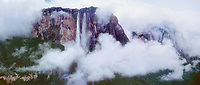 940000017 panoramic view - heavy cloud cover partially shrouds auyan tepui and angel falls the tallest waterfall in the world in remote canaima national park in venezuela