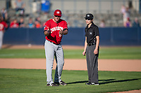 Vancouver Canadians manager Dallas McPherson (23) voices his disapproval of a call made by field umpire Emma Charlesworth-Seiler during a Northwest League game against the Spokane Indians at Avista Stadium on September 2, 2018 in Spokane, Washington. The Spokane Indians defeated the Vancouver Canadians by a score of 3-1. (Zachary Lucy/Four Seam Images)