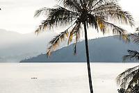 Fishing boat on Lake Toba (Danau Toba) at sunrise, North Sumatra, Indonesia