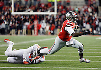 Ohio State Buckeyes quarterback Cardale Jones (12) tries to get away from Illinois Fighting Illini defensive lineman Paul James (97) in the third quarter of the NCAA football game at Ohio Stadium on Saturday, November 1, 2014. (Columbus Dispatch photo by Jonathan Quilter)