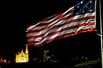 December 18, 2015. U.S; flag at Point State Park at night unfurling in full breeze with St. Mary of the Mount Catholic Church on Mt. Washington in the back ground.