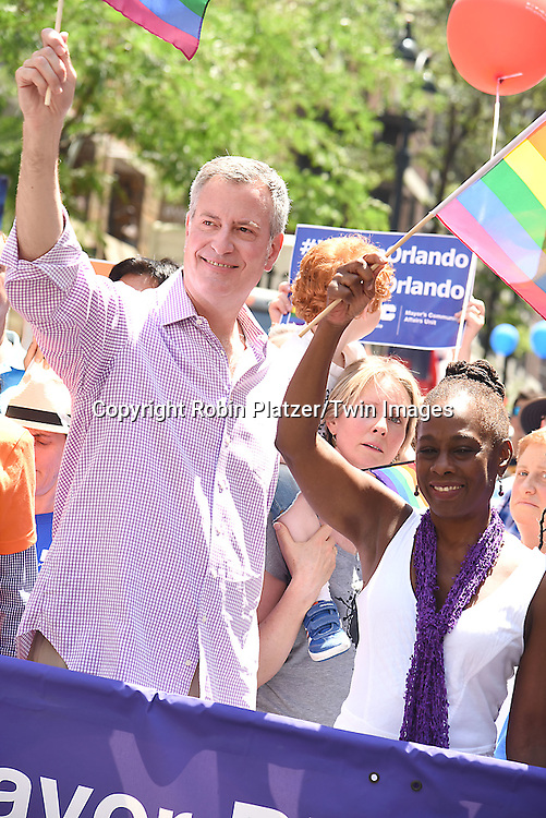 Mayor Bill de Blasio and Chirlane McCray  attend the New York City Gay Pride March 2016 on June 26, 2016 on Fifth Avenue in New York City, New York, USA.<br /> <br /> photo by Robin Platzer/Twin Images<br />  <br /> phone number 212-935-0770