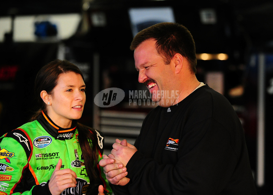 Feb 16, 2011; Daytona Beach, FL, USA; NASCAR Nationwide Series driver Danica Patrick (left) with crew chief Tony Eury Jr during practice for the DRIVE4COPD 300 at Daytona International Speedway. Mandatory Credit: Mark J. Rebilas-