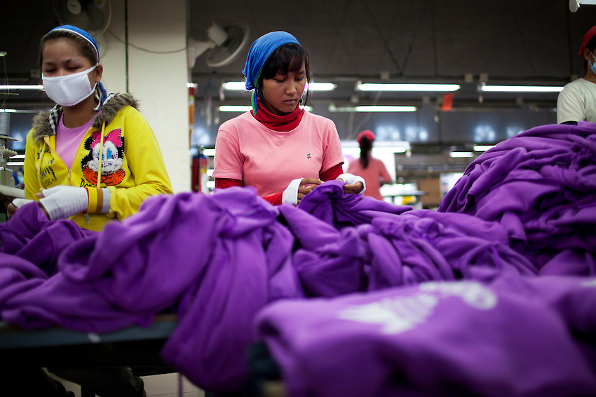 Garment workers make Adidas apparel at the Shen Zhou garment factory in Phnom Penh, Cambodia, October 18, 2011.