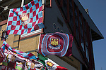 West Ham United 2 Crystal Palace 2, 02/04/2016. Boleyn Ground, Premier League. Home team flags for sale at a stall outside the Bobby Moore Stand at the Boleyn Ground before West Ham United hosted Crystal Palace in a Barclays Premier League match. The Boleyn Ground at Upton Park was the club's home ground from 1904 until the end of the 2015-16 season when they moved into the Olympic Stadium, built for the 2012 London games, at nearby Stratford. The match ended in a 2-2 draw, watched by a near-capacity crowd of 34,857. Photo by Colin McPherson.