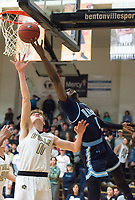 NWA Democrat-Gazette/CHARLIE KAIJO Springdale Har-Ber High School Austin Garrett (1) shoots a layup as Bentonville High School Michael Shanks (11) covers during a basketball game on Friday, January 12, 2018 at Bentonville High School in Bentonville.