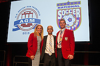San Francisco, CA - Saturday Feb. 14, 2015: US Soccer president Sunil Guilati (center) stands with 2014 US Soccer Hall of Fame inductees Kristine Lilly and Brian McBride speaks after being inducted into the Hall of Fame at the 2014 US Soccer Hall of Fame Induction ceremony.