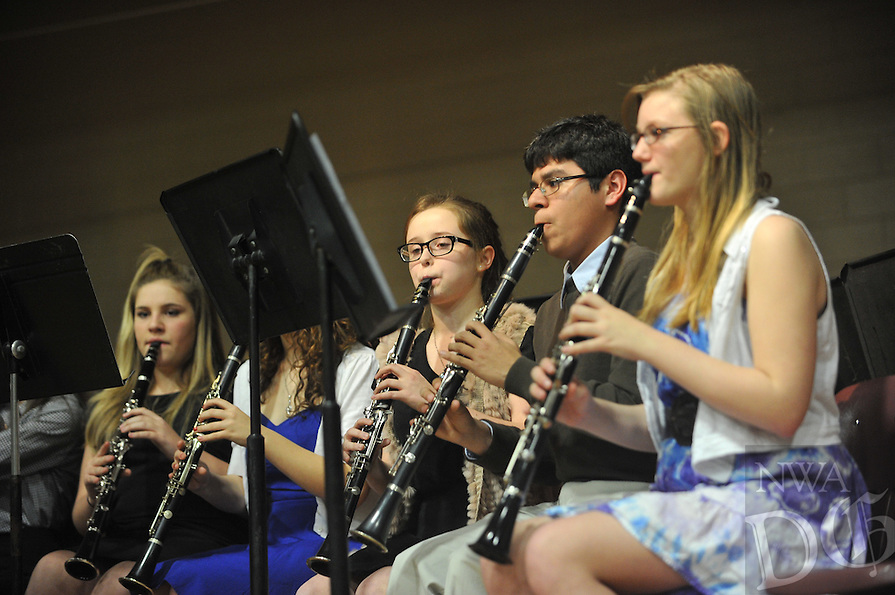 NWA Democrat-Gazette/Michael Woods --03/03/2015--w@NWAMICHAELW... Woodland Junior High students preform Tuesday evening at Woodland Junior High School in Fayetteville during the annual ExtravaBANDza, featuring the schools 18 Chamber Ensembles with the 8th grade Concert Band and the 9th grade Symphonic Band.
