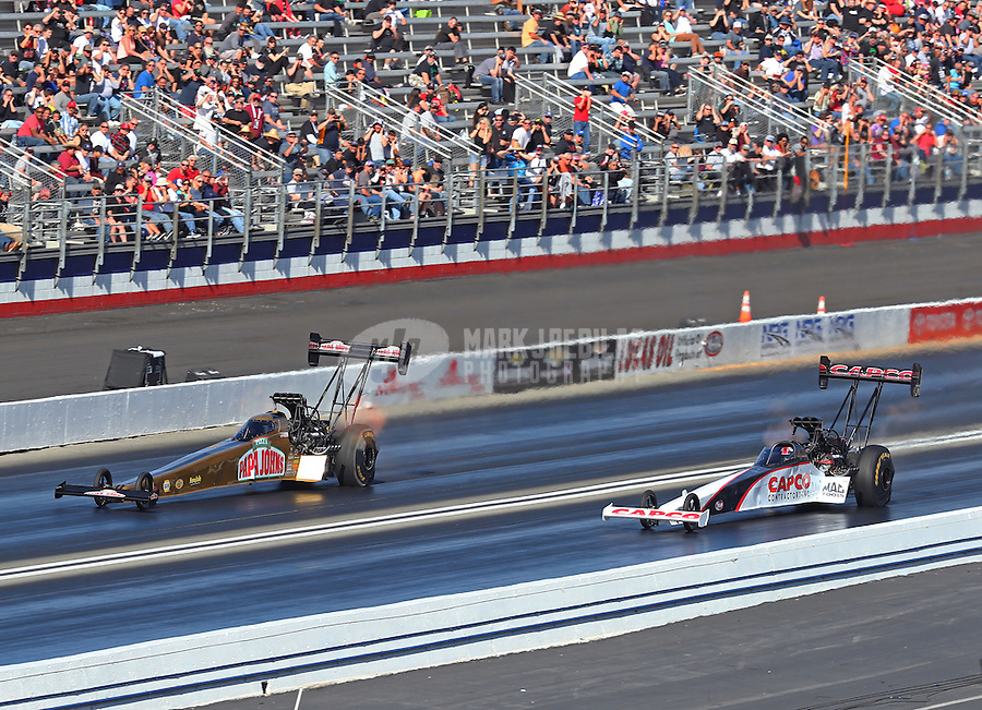 Feb 12, 2017; Pomona, CA, USA; NHRA top fuel driver Leah Pritchett (left) races alongside Steve Torrence during the Winternationals at Auto Club Raceway at Pomona. Mandatory Credit: Mark J. Rebilas-USA TODAY Sports