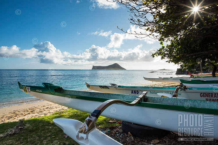 Morning scene at Waimanalo Beach, with outrigger canoes in the foreground and Manana and Kaohikaipu Islands in the distance, Windward O'ahu.