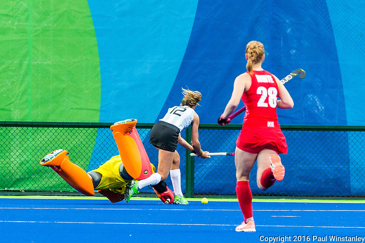 Maddie Hinch #1 of Great Britain comes out of her goal to tackle Delfina Merino #12 of Argentina during Argentina vs Great Britain in women's Pool B game  at the Rio 2016 Olympics at the Olympic Hockey Centre in Rio de Janeiro, Brazil.