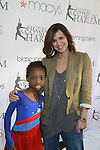 All My Children's Rebecca Budig and skater at the 2012 Skating with the Stars  - a benefit gala for Figure Skating in Harlem celebrating 15 years on April 2, 2012 at Central Park's Wollman Rink, New York City, New York.  (Photo by Sue Coflin/Max Photos)