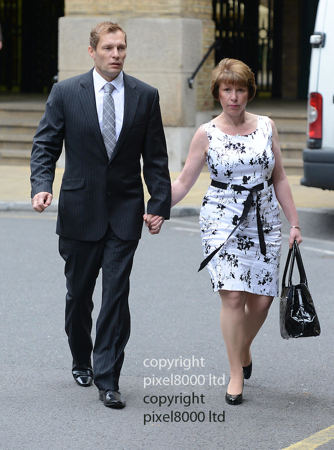 PC Simon Harwood arrives at Southwark Crown Court today .the jury was due to deliver a verdict in his trial for the manslaughter of Big Issue seller Ian Tomlinson..He arrived with his wife Helen.....Pic by Gavin Rodgers/Pixel 8000 Ltd 18.7.12