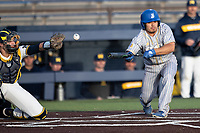 San Jose State Spartans catcher Johnny Mendoza (9) attempts to bunt against the Michigan Wolverines on March 27, 2019 in Game 2 of the NCAA baseball doubleheader at Ray Fisher Stadium in Ann Arbor, Michigan. Michigan defeated San Jose State 3-0. (Andrew Woolley/Four Seam Images)