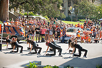 Dancers. Homecoming gets kicked off with the traditional car parade through the quad, Thursday, Oct. 23, 2014. (Photo by Marc Campos, College Photographer)