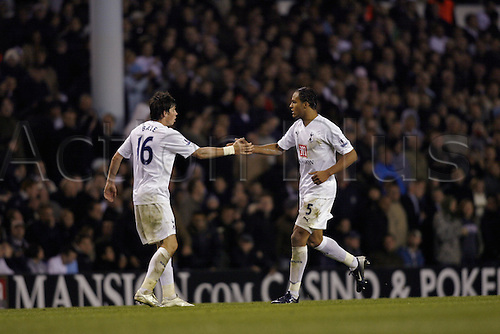 26 September 2007: Tottenham defender Younes Kaboul celebrates the second goal with Gareth Bale during the Carling Cup game between Tottenham Hotspur and Middlesbrough, played at White Hart Lane. Spurs won the match 2-0. Photo: Actionplus....070926 football soccer player keeper joy
