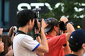 Serious amateur photographers covering outdoor summer event in downtown Montreal