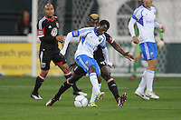 Montreal Impact forward Sanna Nyassi (11) shields the ball from D.C. United defender Brandon McDonald (4) D.C. United tied The Montreal Impact 1-1, at RFK Stadium, Wednesday April 18 , 2012.