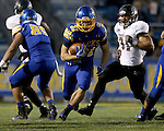 BROOKINGS, SD - OCTOBER 11:  Zach Zenner #31 from South Dakota State looks for an opening past Dylan Cole #31 from Missouri State in the first half of their game Saturday evening at Coughlin Alumni Stadium in Brookings. (Photo/Dave Eggen/Inertia)