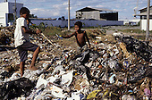 Rio de Janeiro, Brazil; Children sorting through rubbish at the municipal rubbish dump.